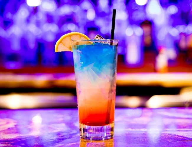 Colorful drink on a bar