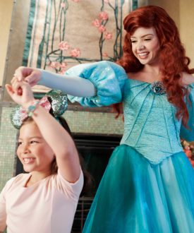 Ariel dancing with little girl at Disneyland