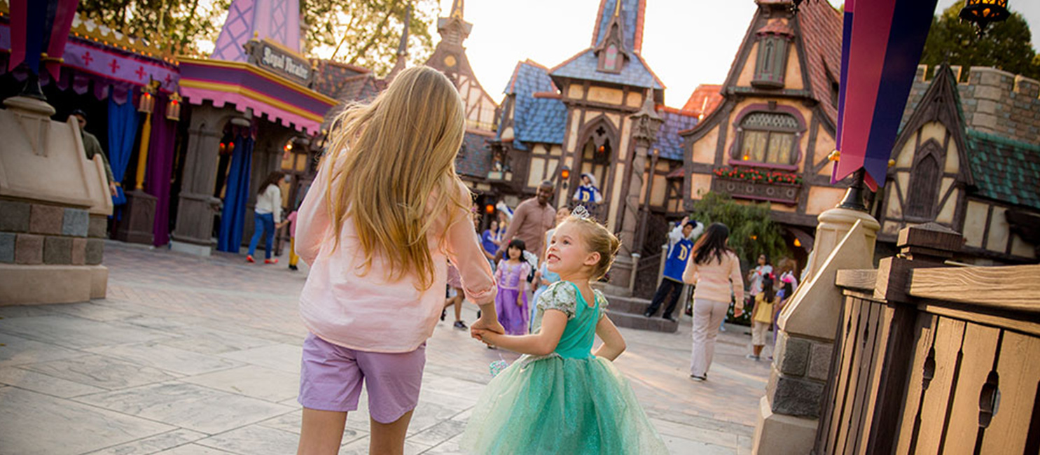 two girls dressed as princesses at disneyland