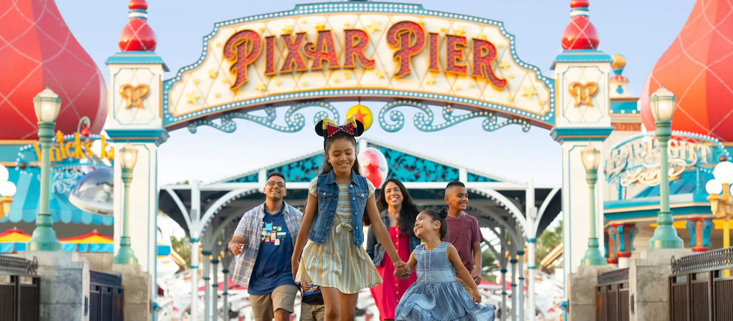 Kids walking with their family on Pixar Pier at California Adventure Park