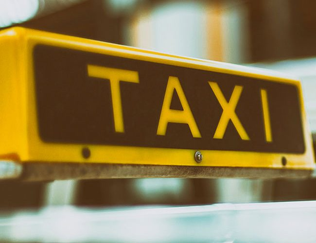 taxi sign on taxi cab