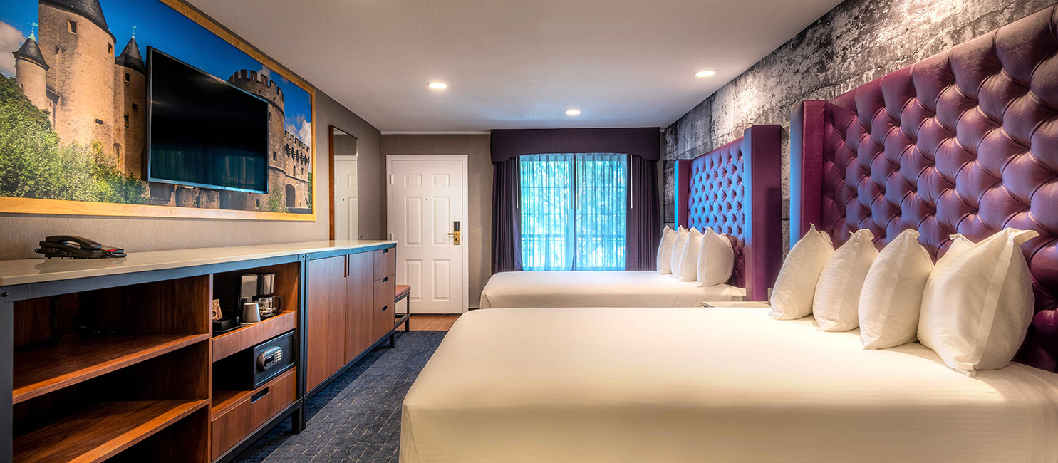 Newly renovated double queen room with purple headboards