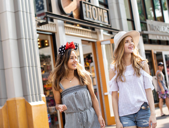 teen girls walking through downtown disney