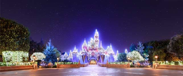 christmas lights cover the castle at disneyland